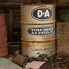 Oil drum in forgotten building.