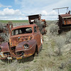 Car and combines rusting away.