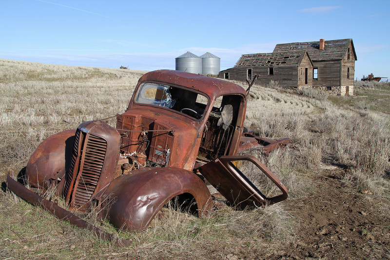 Forgotten dodge truck and farm house.
