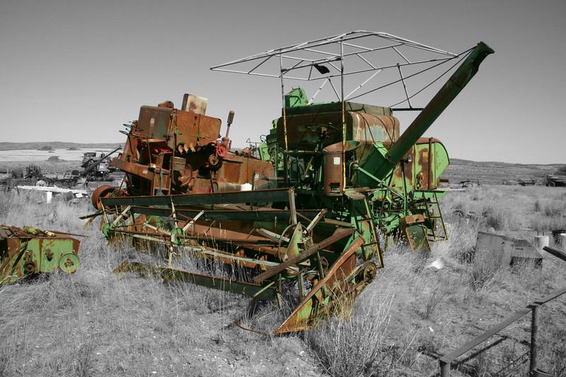 Rusting combines in combine grave yard.