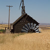 Fallen windmill near wheat.