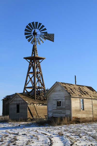 Roof top windmill and weathered outbuilding.