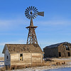 Roof top windmill and weathered barn.