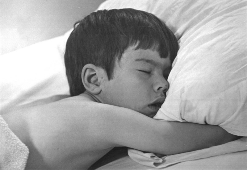 T was sent to his room for being naughty and fell asleep, dirty face and all.<br /> This was shot as an assignment for my photography class in college, probably 1969.