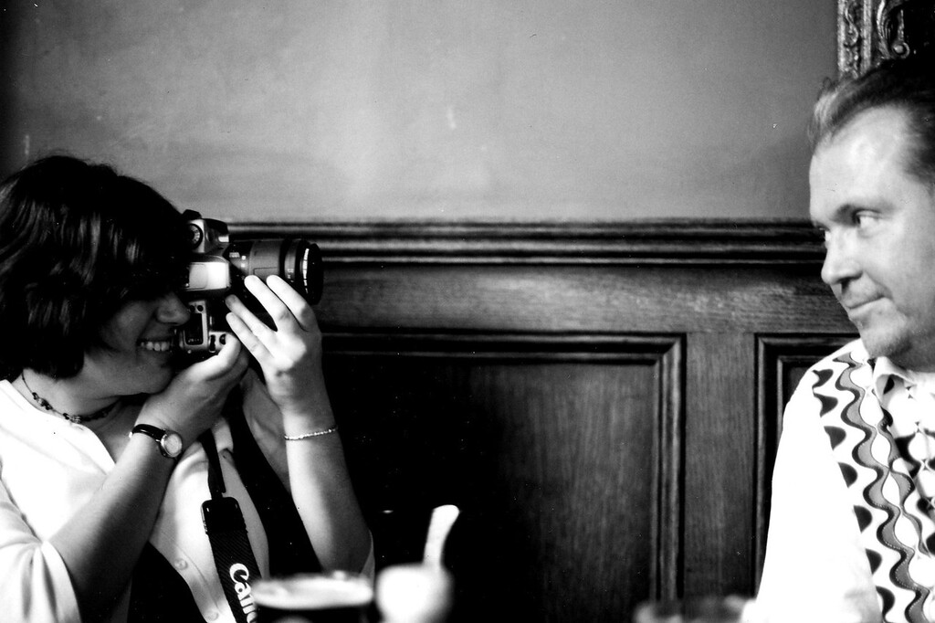 Student taking her professor's picture in Finnegan's Wake (London pub)
