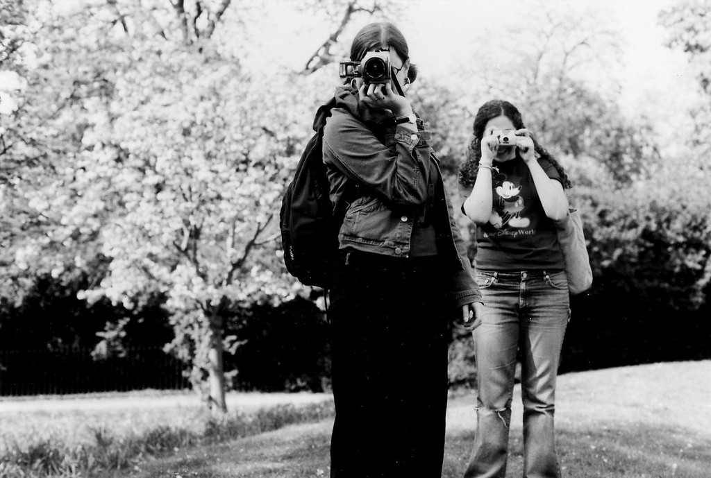 Two friends taking my picture in Hyde Park (London)