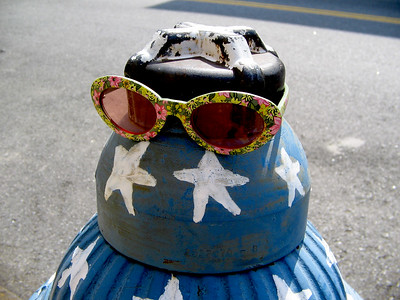 Fire hydrant painted like American flag, with sunglasses, in Brooklyn