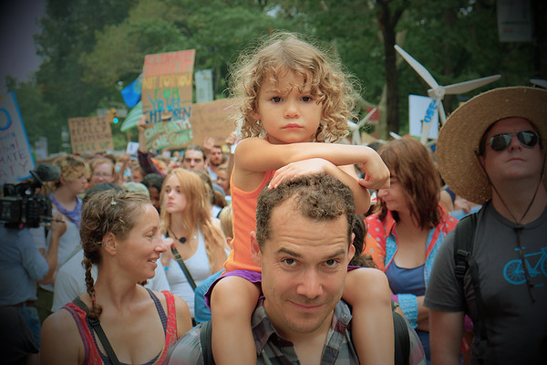 Manhattan. People's Climate March, Central Park West, 2014. My camera caught the eye of this man and little girl at the same moment.