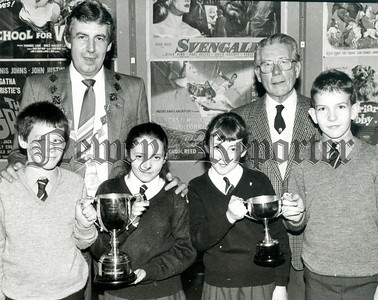 St Pauls High School Bessbrook recieved the Special Lions Club Achievement Award and sthe Tyrone Cup for Best Rural School. Also in photograph. President Michael Toner and Mr G McConaghy Newry Lions Club. R8902109