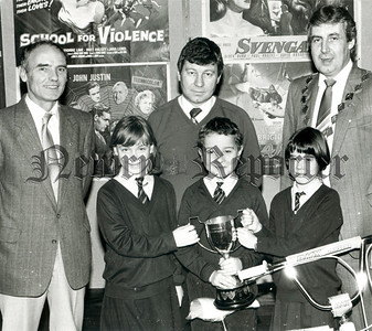 Runner-up in the Rural School Sectin Jonesboro Primary School pupils their teacher Mr Seamus McKeever who were awaredthe Rural Schools Cup. Also in photograph President Michael Toner and Mr D. Gallespie, Newry Lions Club.