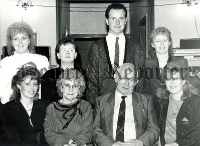 Home from America A family reunion took place in Bennetts Lounge, Warrenpoint last friday evening when the Crawford Family of 17 Aughnamoira Road held a party which was attended by two of their daughters on holiday from the USA. Above are seen mr and Mrs Peter Crawford (centre front) with seated on right Serena and (left Breige who live in New Jersey. (Back row), left to right are other members of the family. Mrs Angela Quinn, Carol, Anthony and Mrs Mary Henderson.