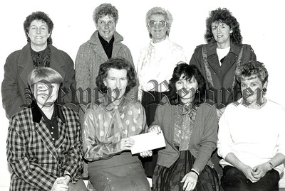 Miss Ethel Fitzpatrick, Choirmistress and founder of the Phoenix Singers presents a cheque for £810 to Miss Jennifer Malone (right) Chairperson of the Newry Concern Group. The money was raised at a sponsored carol service in the Buttercrane Shopping centre at Christmas. Also in photograph some of the choir members. R8904102