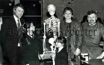 January 1989 - No dear the gentleman hasnt been taking school dinners A young visitor to St Marks Biology Department looks askance while teacher Ms A McNeice (second from right) and Head of Science Mr N Powell (right) meet some of the pupils and parents. R8905118