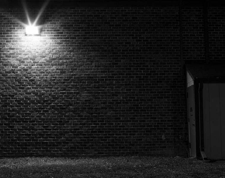 lamp, brick wall, and tool shed