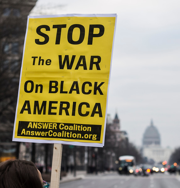 protest sign and U.S. Capitol, 01/15/15