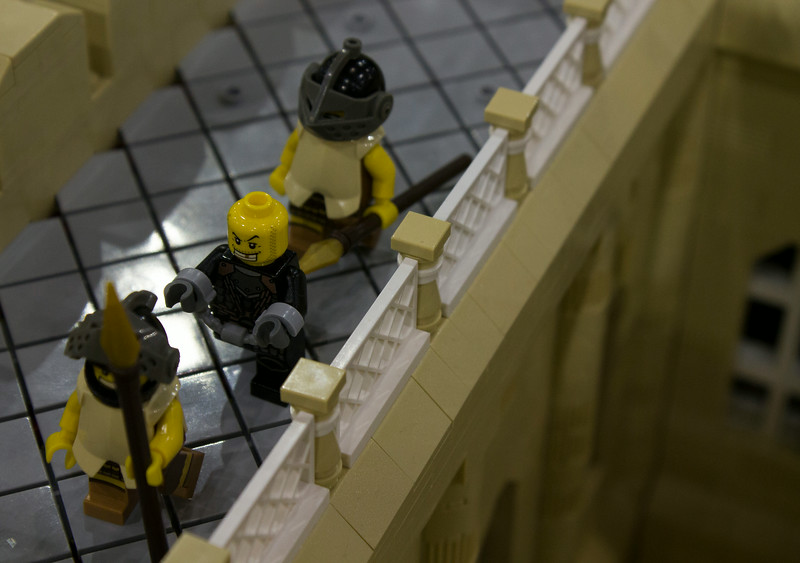 BrickFair VA 2014, prisoner and guards on castle walkway