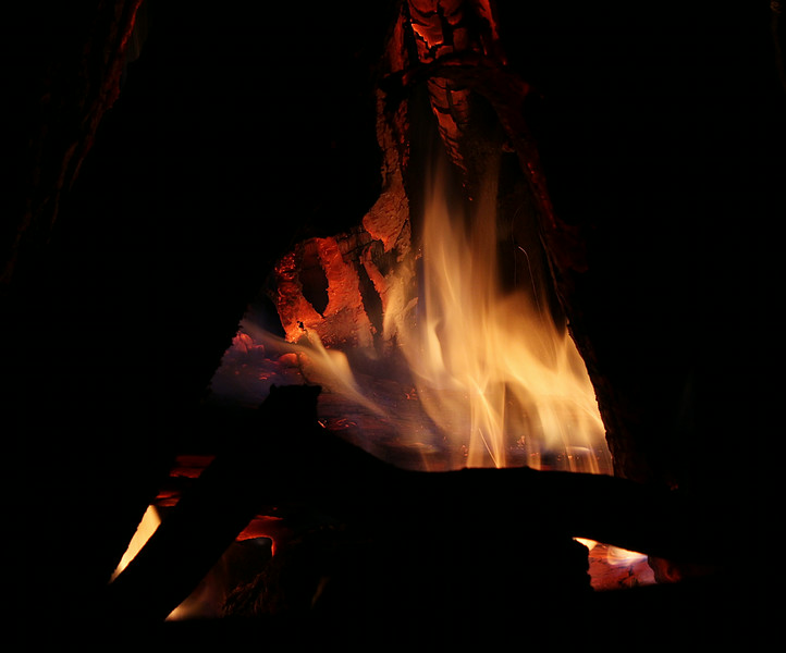 log burning inside campfire