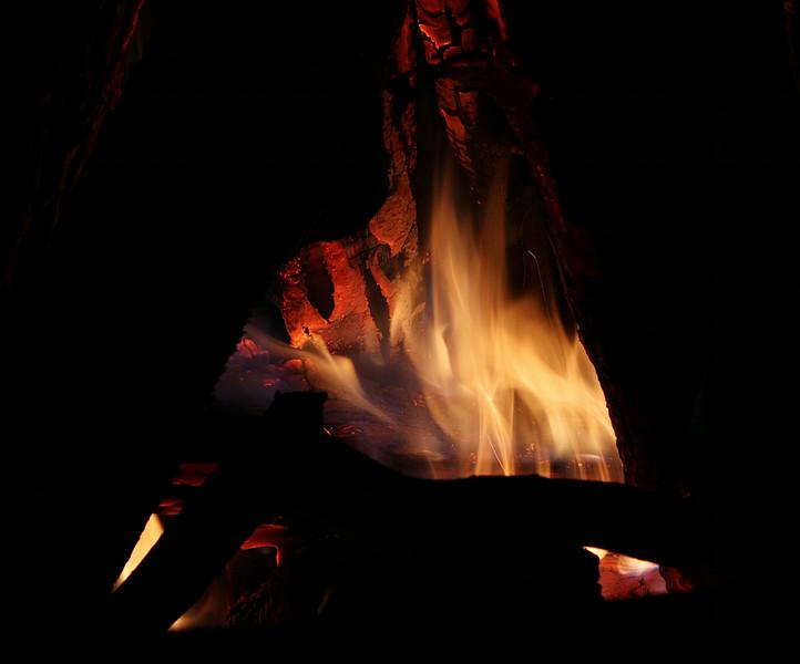 log burning inside campfire