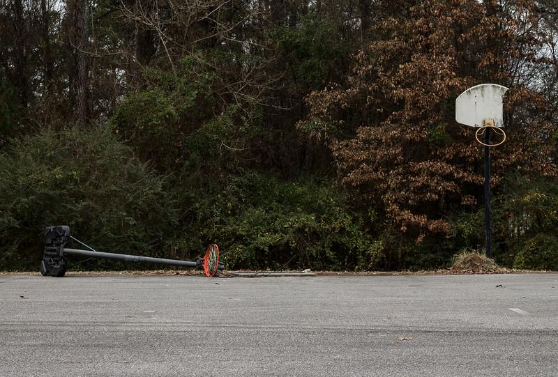 broken basketball goals in parking lot