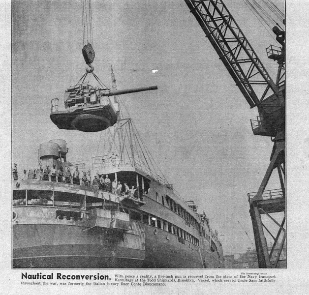 Newspaper clipping: At the end of the war a five inch gun is removed from the stern of the Hermitage at Todd Shipyards in Brooklyn, NY.