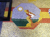 """Welton Becket's terrazo sidewalk mosaics encapsulate the SoCal experience.<br /> If you look closely, you can see the descriptive word in the black and white pavement, i.e., here we have the word - """"beaches""""."""