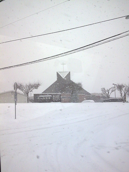 A Church Through the Light of the Snow