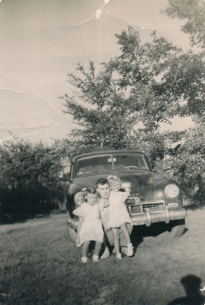 "From L-R:  Loretta ""Tub"" Peyton, Bobby Peyton, and Linda ""Pete"" Peyton.   Also on the back of the photo is ""1947 Kaiser"""
