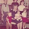 "From L-R:  Steve Peyton, Richlyn Whitis, Emma ""Granny"" Peyton, Jeanie Peyton, Kim Peyton (sitting in Granny's lap) Marsha Peyton, and Donna Peyton."