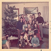 "Sitting on the floor L-R is Greg Mueller and Brad Whitis.   Emma ""Granny"" Peyton is holding Terri Whitis on the left and Christy Peyton on the right.   Behind Granny from L-R is Kim Peyton,  Richlyn Whitis, Donna Peyton, Tonya Peyton and Lisa Thompson.   Back row from L-R is Jeanie Peyton (holding Jana?), Marsha Peyton holding (Jamey) and Steve Peyton.    Date on back of photo is Christmas 1971."
