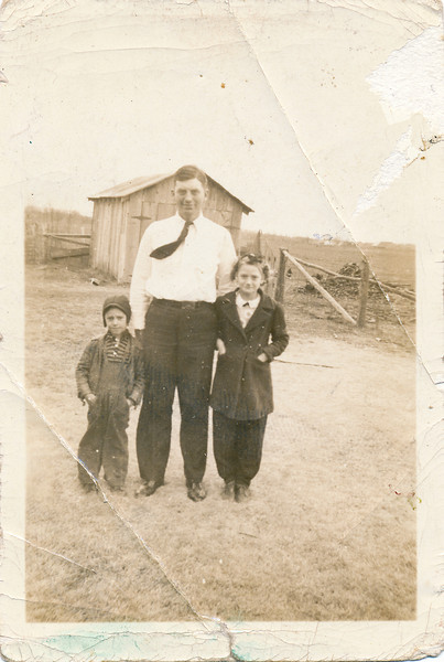From L-R:  Don Peyton, Uncle Guy Thompson, and June Peyton.  Date on back of photo is January 10, 1943
