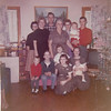 "From L-R in front are:  Richlyn Whitis, Steve Peyton, Donna Peyton, Marsha Peyton, Jeanie Peyton, Jeanie is holding Brad Whitis.   Back from L-R is Loretta Peyton Whitis, June Peyton Thompson, Bobby Peyton, Emma ""Granny"" Peyton, Linda Peyton Mueller, Kim Peyton is being held by Don Peyton..   Date on back of photo is Christmas 1961."
