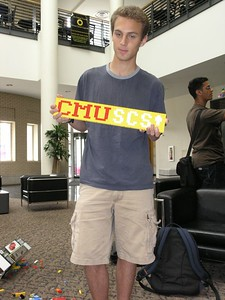 Matt models with his CMU SCS sign
