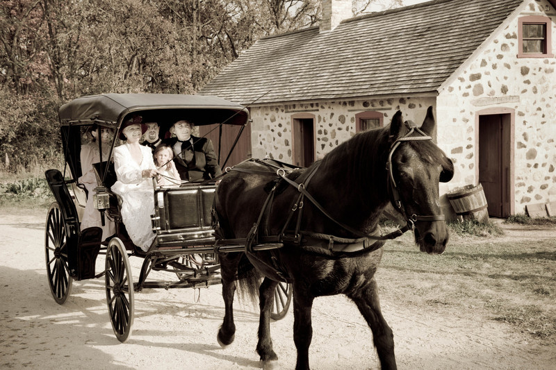 The whole family is out for a Sunday buggy ride through the German Schottler farm.