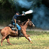 Cavalry engage in a skirmish at the Civil War reenactment at Old World in September, 2003.