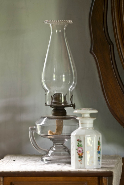 Oil lamp on a dresser in the 1875 Benson house parlor.