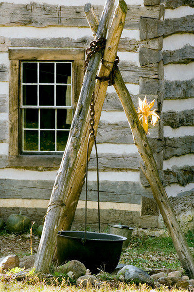 Tripod mounted kettle outside Fossebrekke farmhouse.