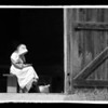 "An interpreter sits in the entrance to the Grube barn on the 1860 Schulz farm.  This image reminds me of the famous painting ""Whistler's Mother."""