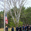 Morning flag raising at Harmony Hall during the Civil War reenactment.,