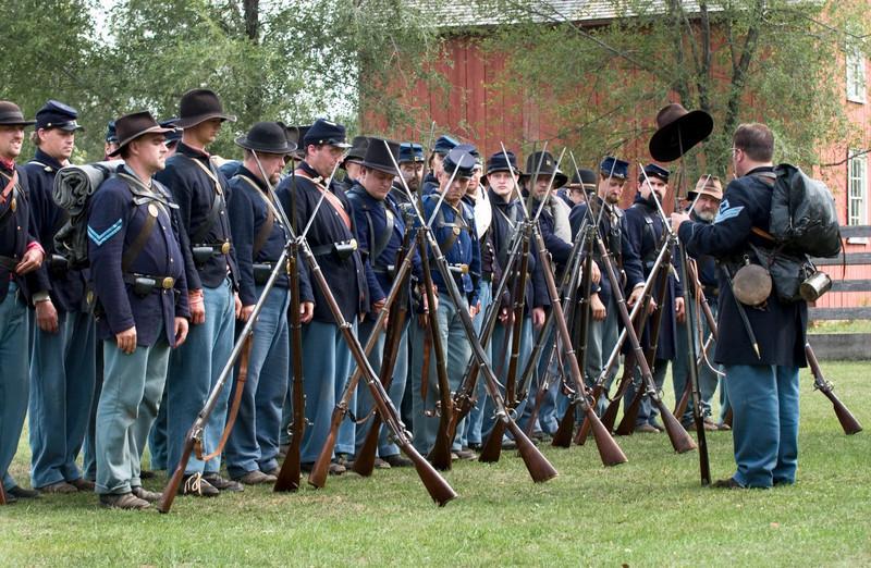 Civil War reenactors at their morning muster in Crossroads Village.