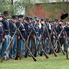 Civil War reenactors at their morning muster in Crossroads Village.