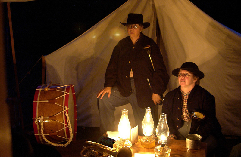 A Civil War reenactors band gives an evening concert in their tent encamptment.