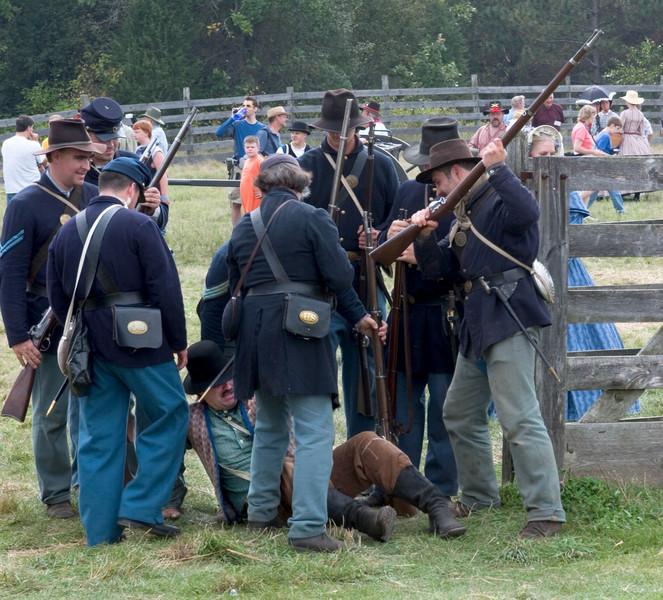 Union soldier reenactors capture a deserter in Crossroads Village.