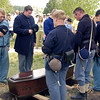 Civil War reenactors at a graveside funeral service in the St. Peter's churchyard.