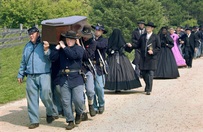 A Civil War funeral procession in Crossroads Village headed to St. Peters church where a graveside service and burial took place.