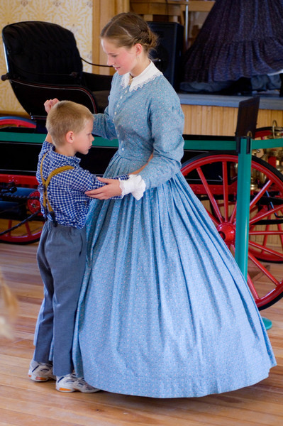 Young visitors learn how to dance in Caldwell educational center.