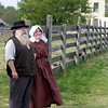 Civil War reenactors look over Crossroads Village.  Four Mile Inn is in the background.