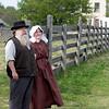 Civil War reenactors look over Crossroads Village.  Four Mile Inn is in the background.