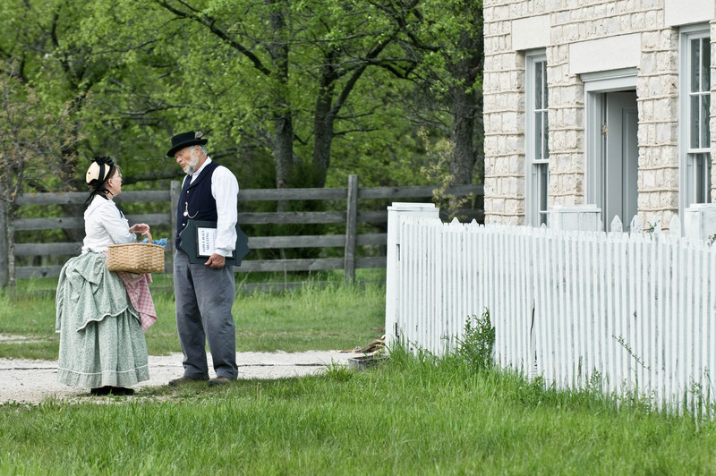 Two interpreters discuss a proposed dog tax outside the Thomas general store in Crossroads village.
