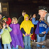A blacksmith talks to a group of schoolchildren in the Grotelueschen blacksmith shop in Crossroads village.