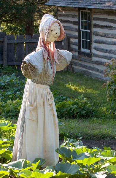 A happy scarecrow guards the garden at the 1890 Pedersen (Danish) farm.